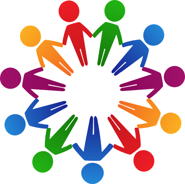 Circle of different colored people holding hands
